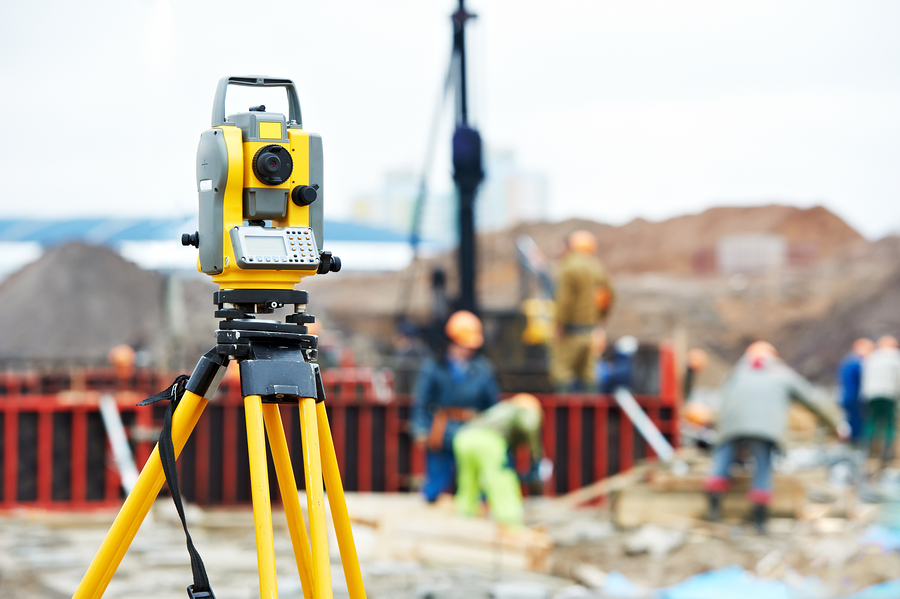 Surveying measuring equipment theodolite transit on tripod at co